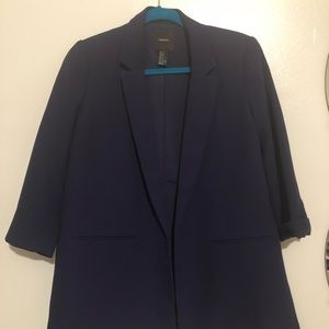Navy blue blazer with slits on the sides